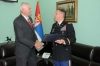 New USA Defence and Land Forces Attache Hands Colonel Branislav Anocic with the